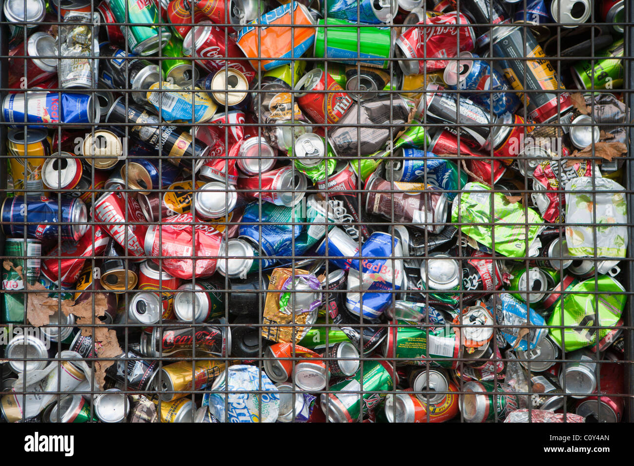 Recycling cage full of aluminium drinks cans, New Zealand. - Stock Image