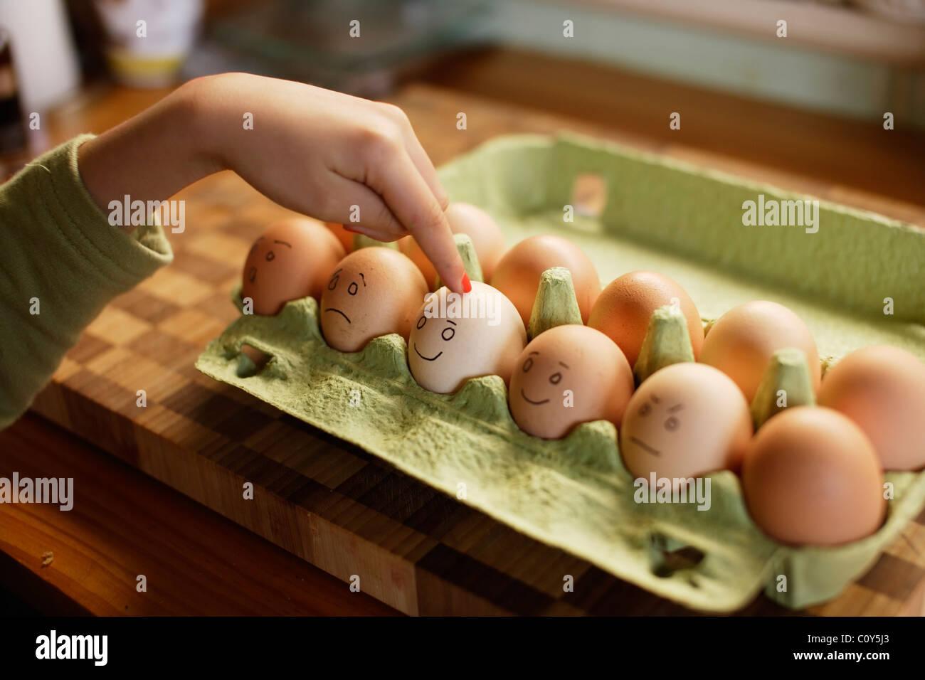 Organic free range eggs in green egg box. - Stock Image