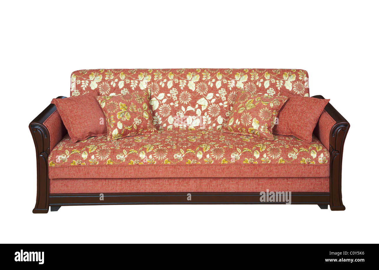 Wooden sofa with floral pattern upholstery - cutout - Stock Image