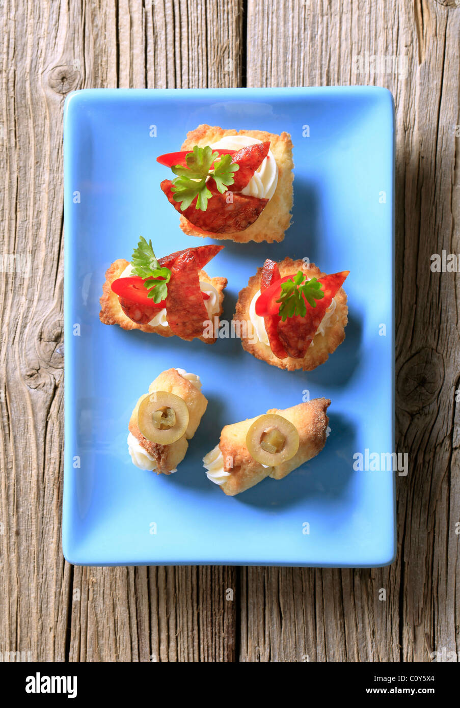 Variety of canapes on a porcelain plate - Stock Image