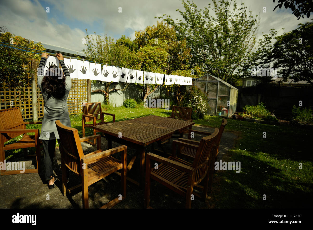 Hands on washing line. - Stock Image