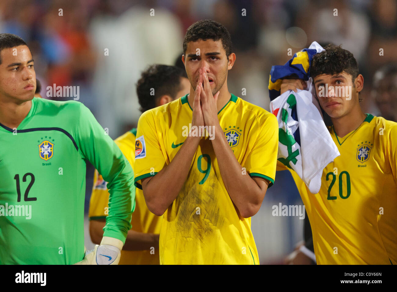 Brazil players Renan Ribeiro (12), Alan Kardec (9) and Ciro (20) react after being defeated by Ghana in the FIFA - Stock Image