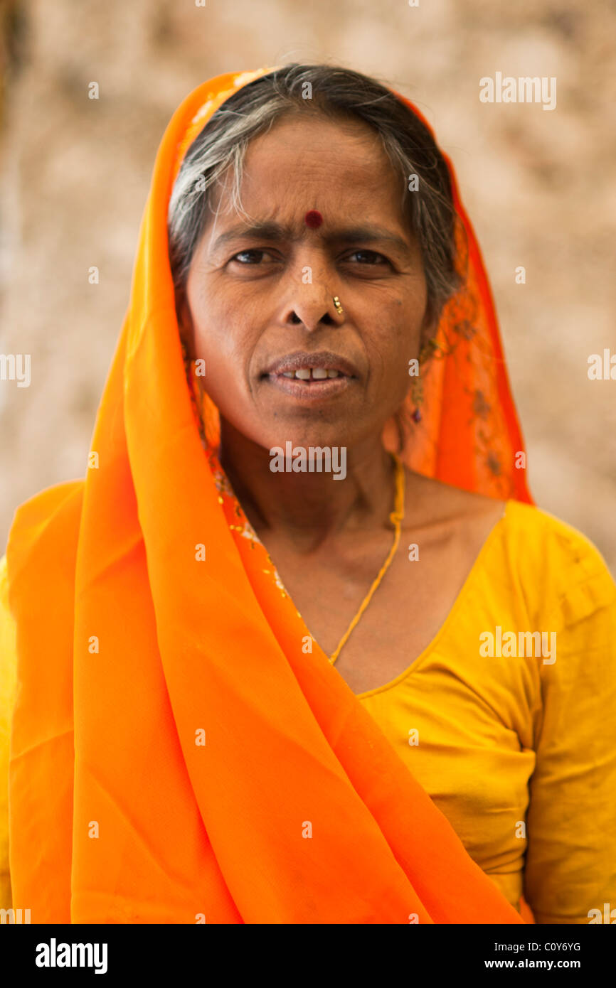 Portrait of an Indian Woman in a yellow sari. Stock Photo
