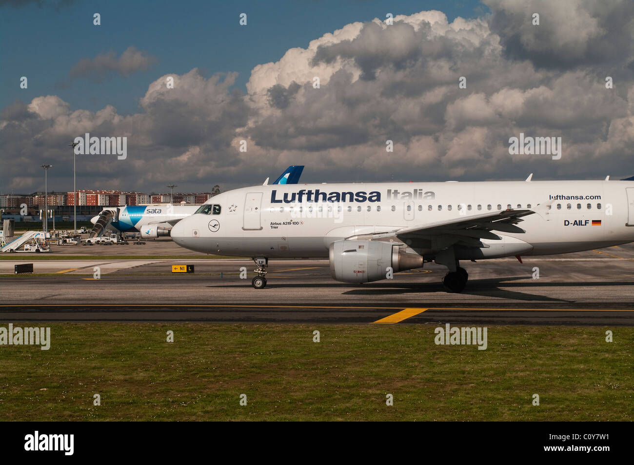 Lufthansa airplane moving into position on the runway for take off - Stock Image