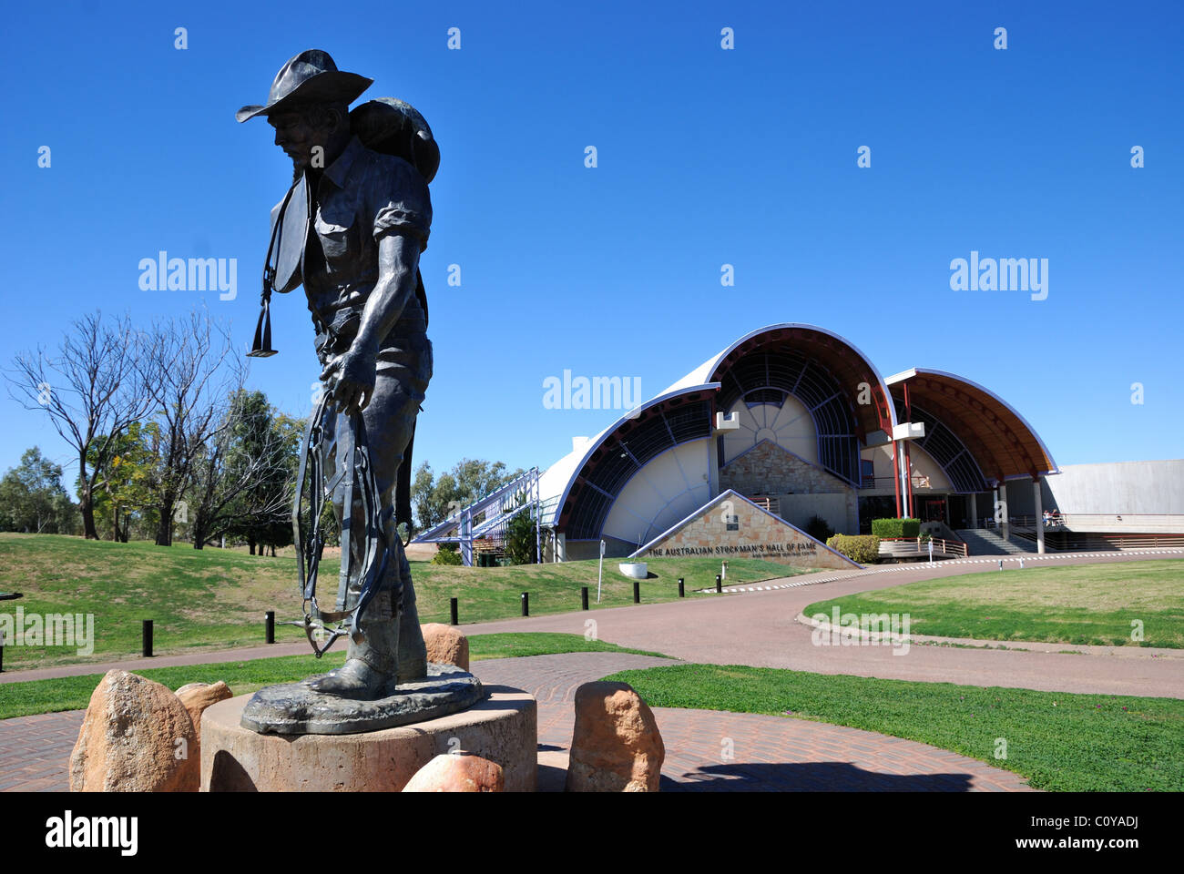 Stockman statue with Stockman's Hall of Fame building in the background, Longreach, Queensland, Australia. - Stock Image