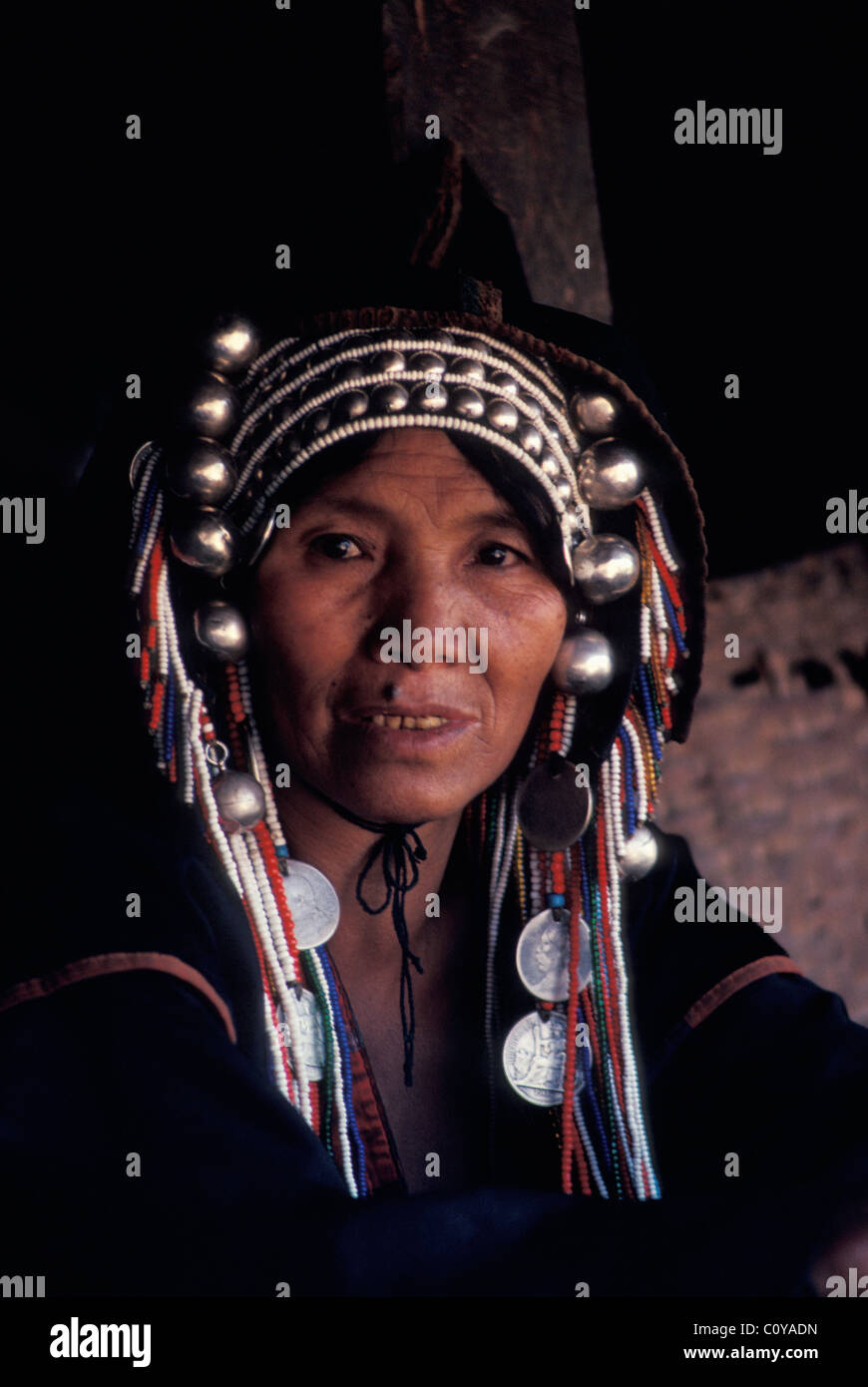 Akha hill tribeswoman in traditional silver headdress Northern Thailand - Stock Image