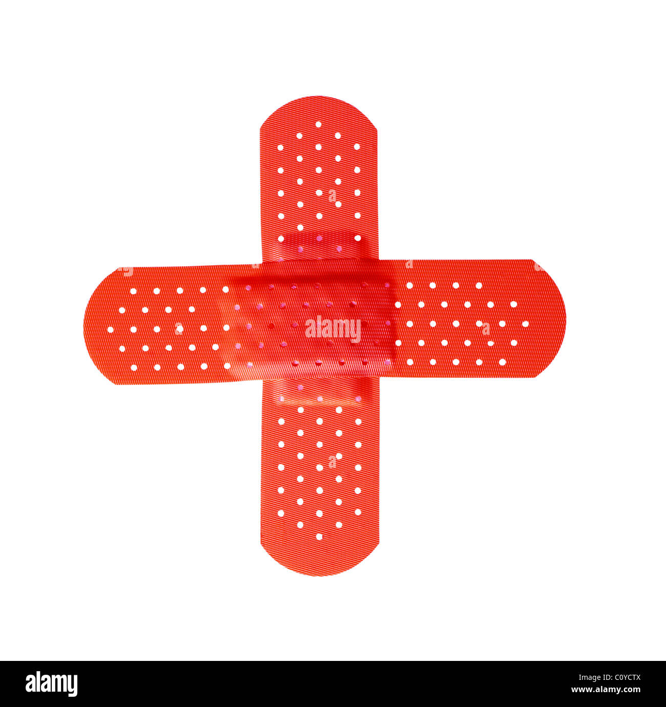 Red cross formed by two bandages isolated on white background - Stock Image