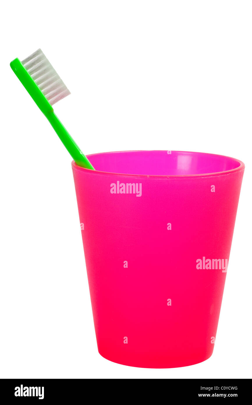 Toothbrush and cup for kids isolated on white background - Stock Image