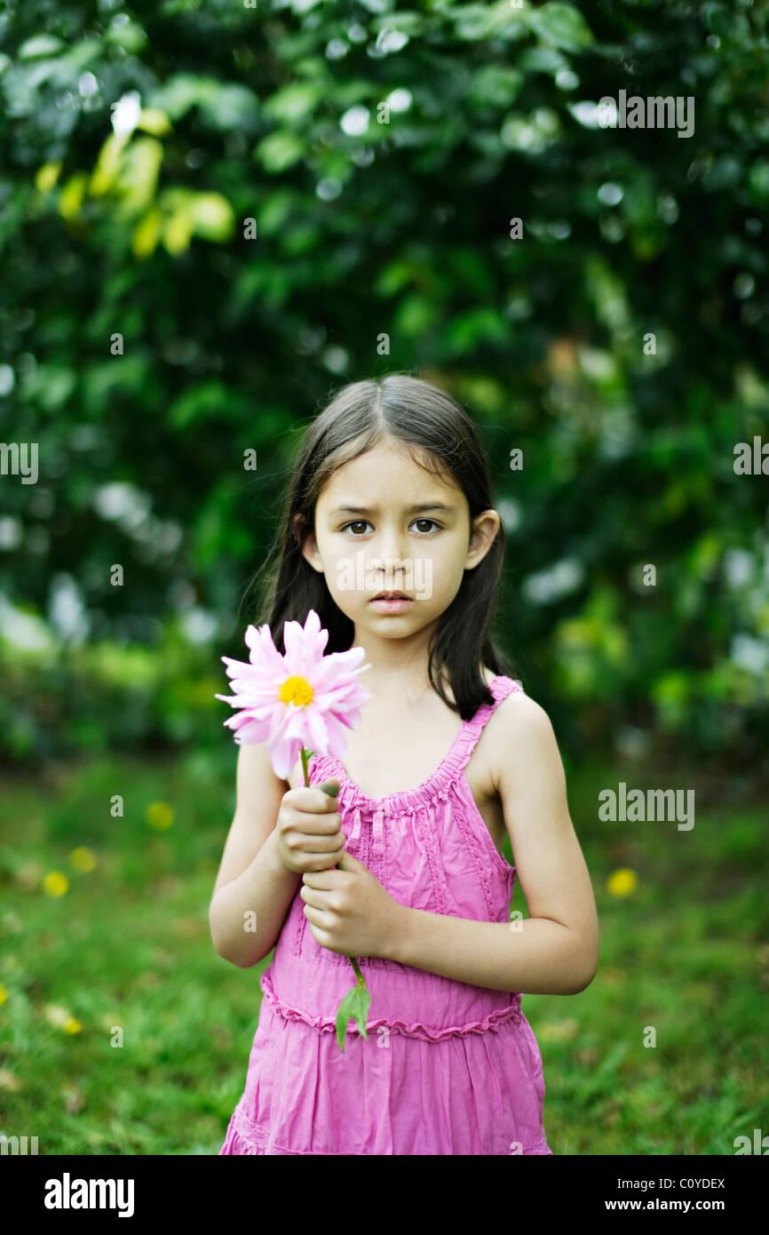 Girl holding flower - Stock Image