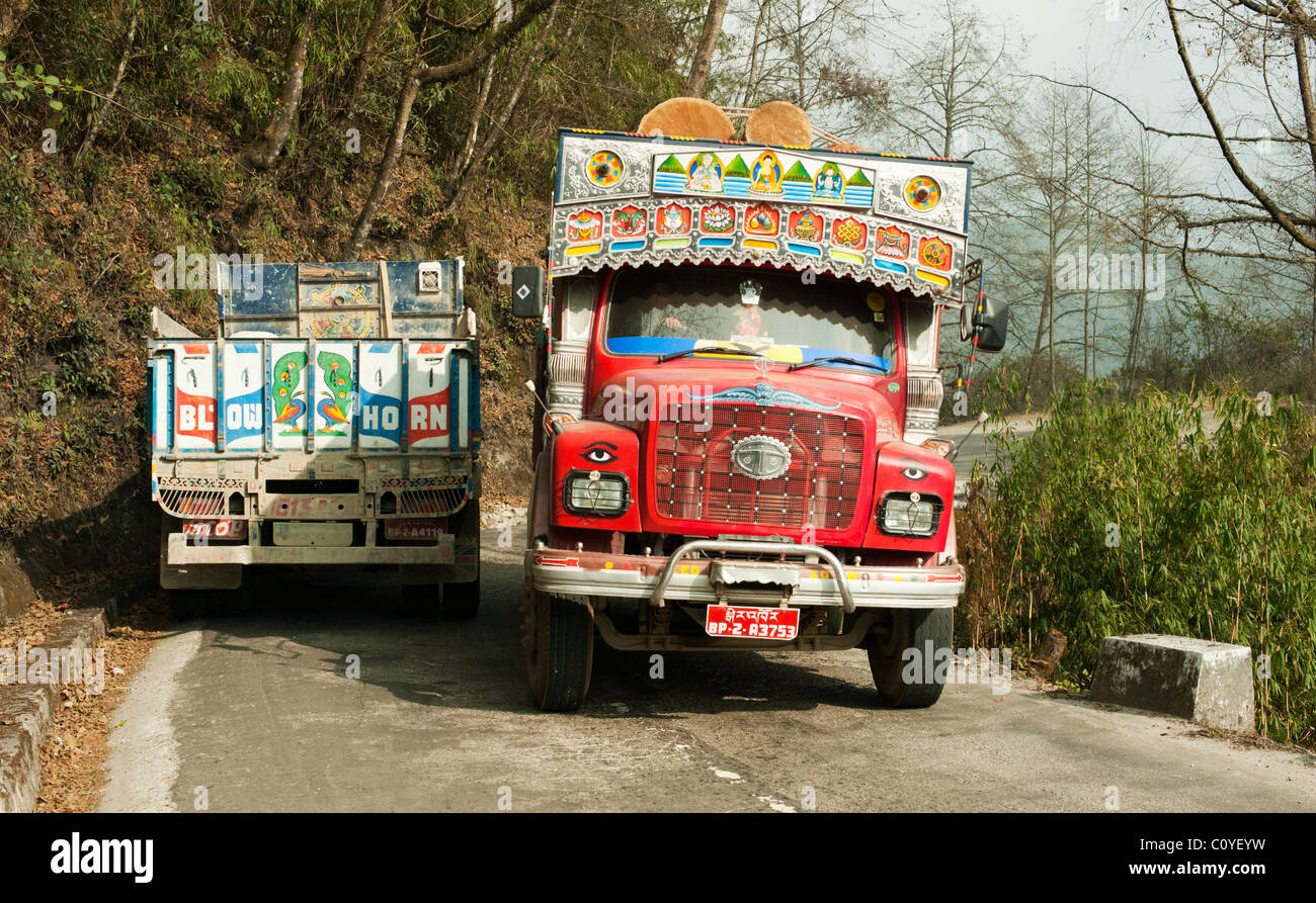 Two Bhutanese trucks passing on a narrow road in central Bhutan - Stock Image
