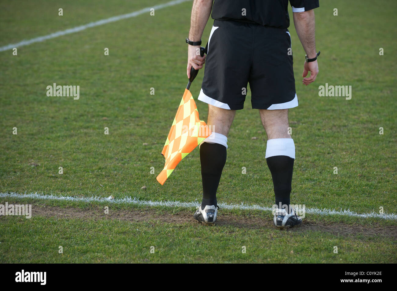Linesman at a football/ soccer match - Stock Image