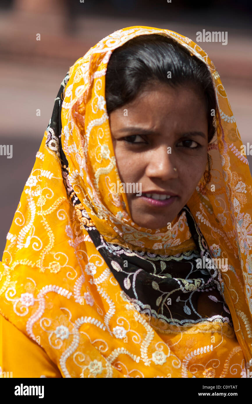 Portrait of an Indian woman dressed in sari who came to visit the Mosque Stock Photo