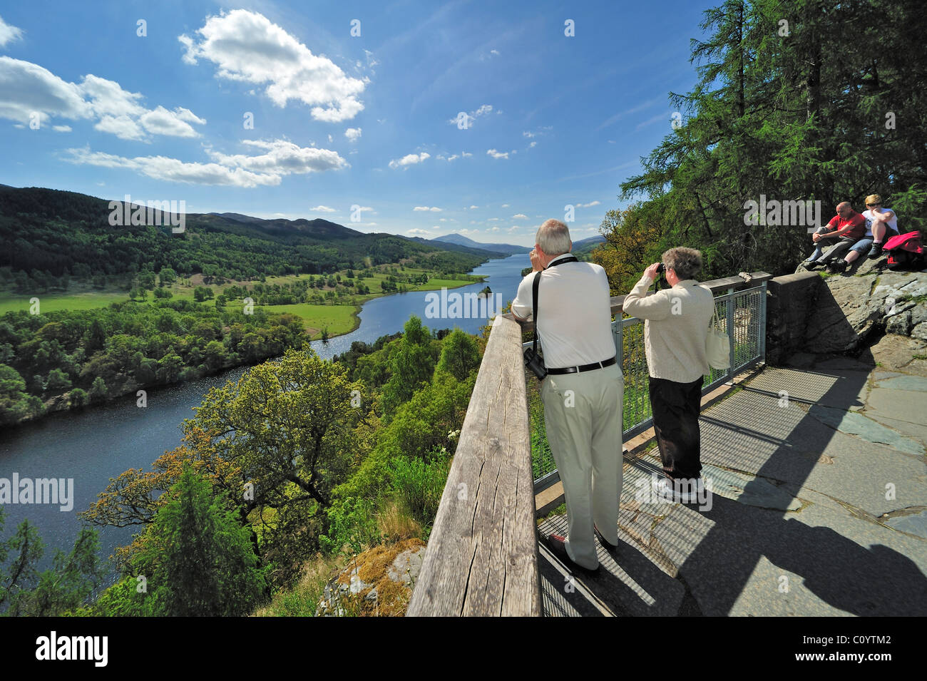 Tourists looking over Loch Tummel from Queen´s View near Pitlochry in Perth and Kinross, Scotland, UK Stock Photo