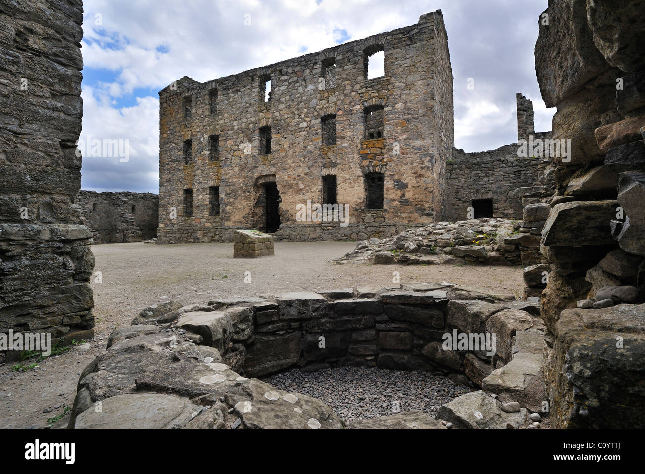 Well at courtyard among the ruins of Ruthven barracks near Kingussie, Highlands, Speyside, Scotland, UK - Stock Image