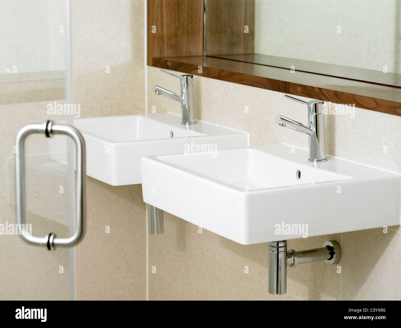 Interior shot of bathroom sinks - Stock Image