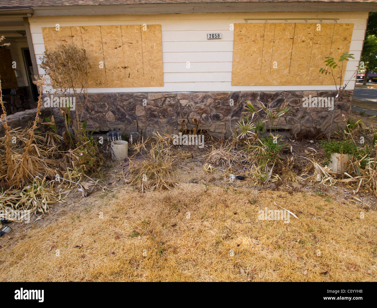 Boarded up foreclosed home in Fresno, California, United States - Stock Image