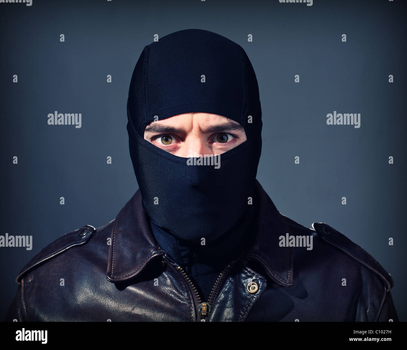 fine portrait of white thief with black balaclava - Stock Image