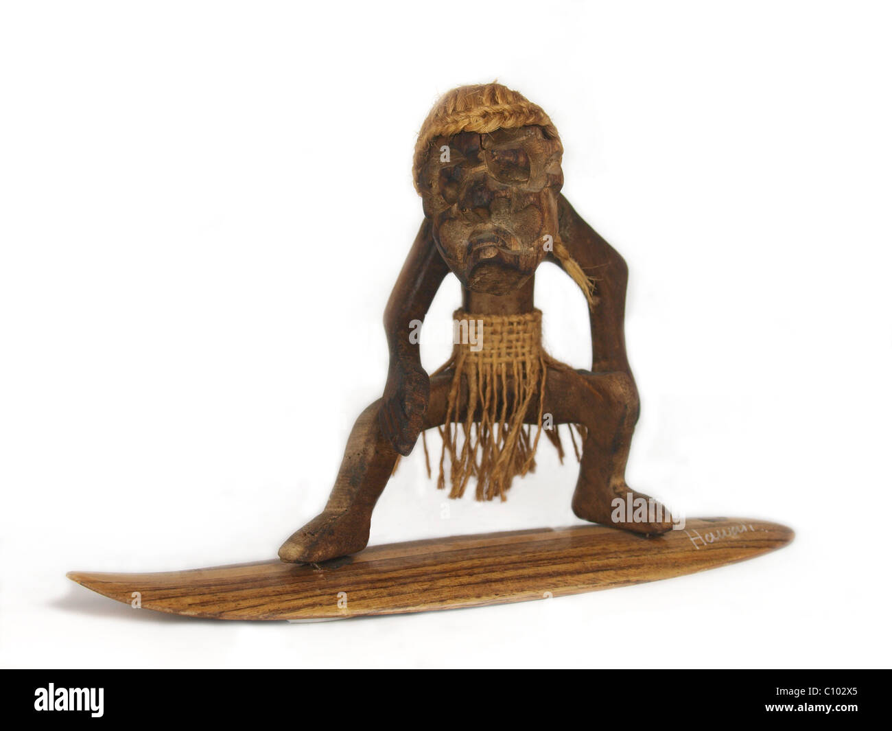 Tourist memento of a surfer from Hawaii - Stock Image