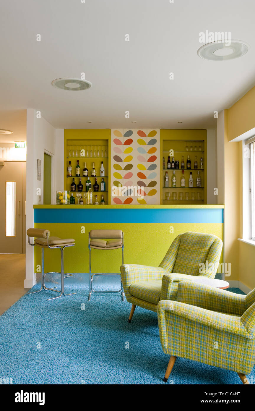 Bar area in Big Sleep 1970s boutique hotel with iconic retro pieces and 20th century design - Stock Image