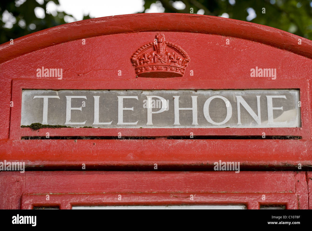 The domed roof of a red  K6 telephone box. - Stock Image