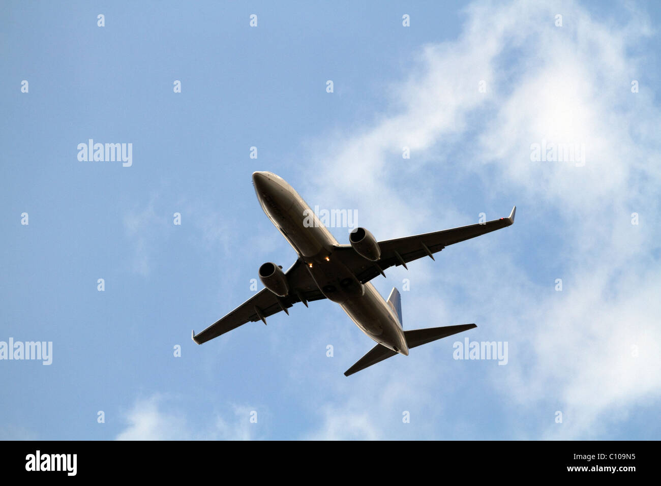 A Continental Airlines airplane flying over the Meadowlands approaching Newark Airport in New Jersey, USA - Stock Image