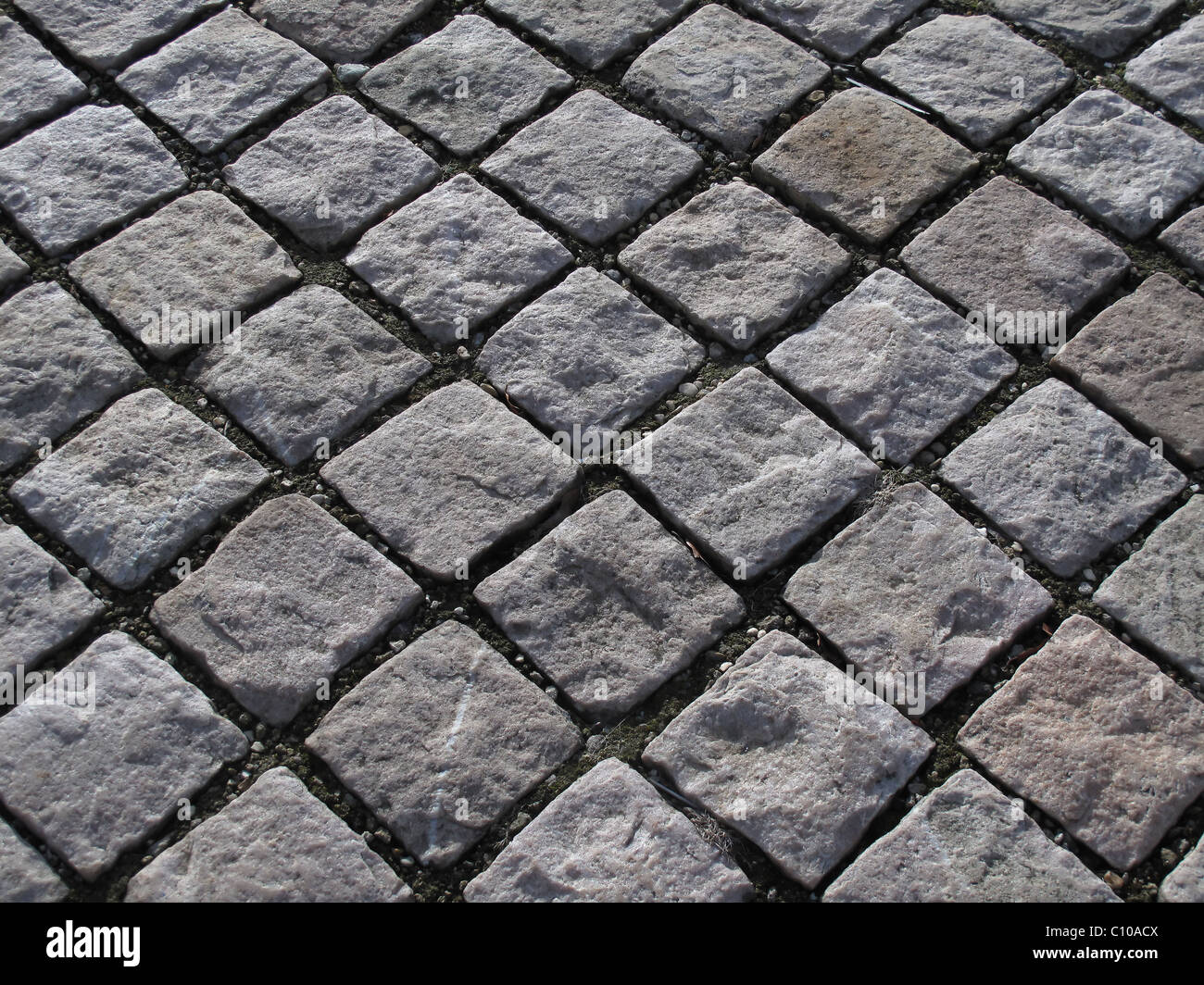 Cobbles or setts in a diagonal pattern - Stock Image