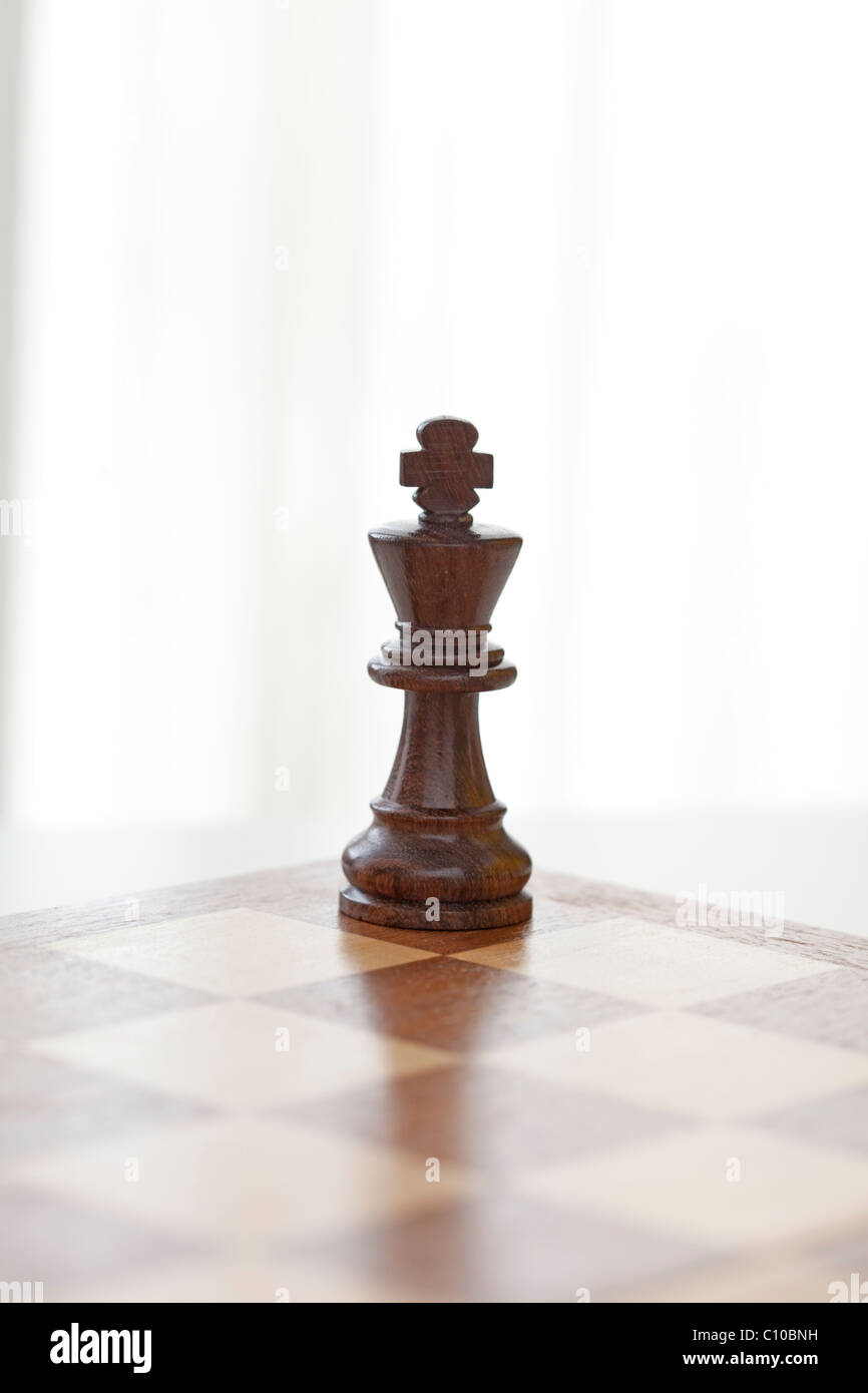 chess piece king stands alone - Stock Image