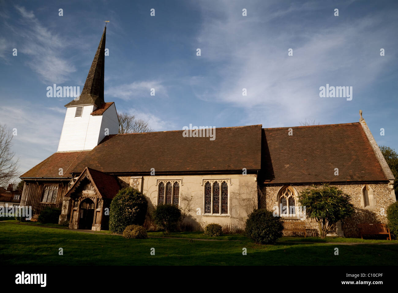 All saints Church at sunset, in the village of Stock, Essex, UK - Stock Image