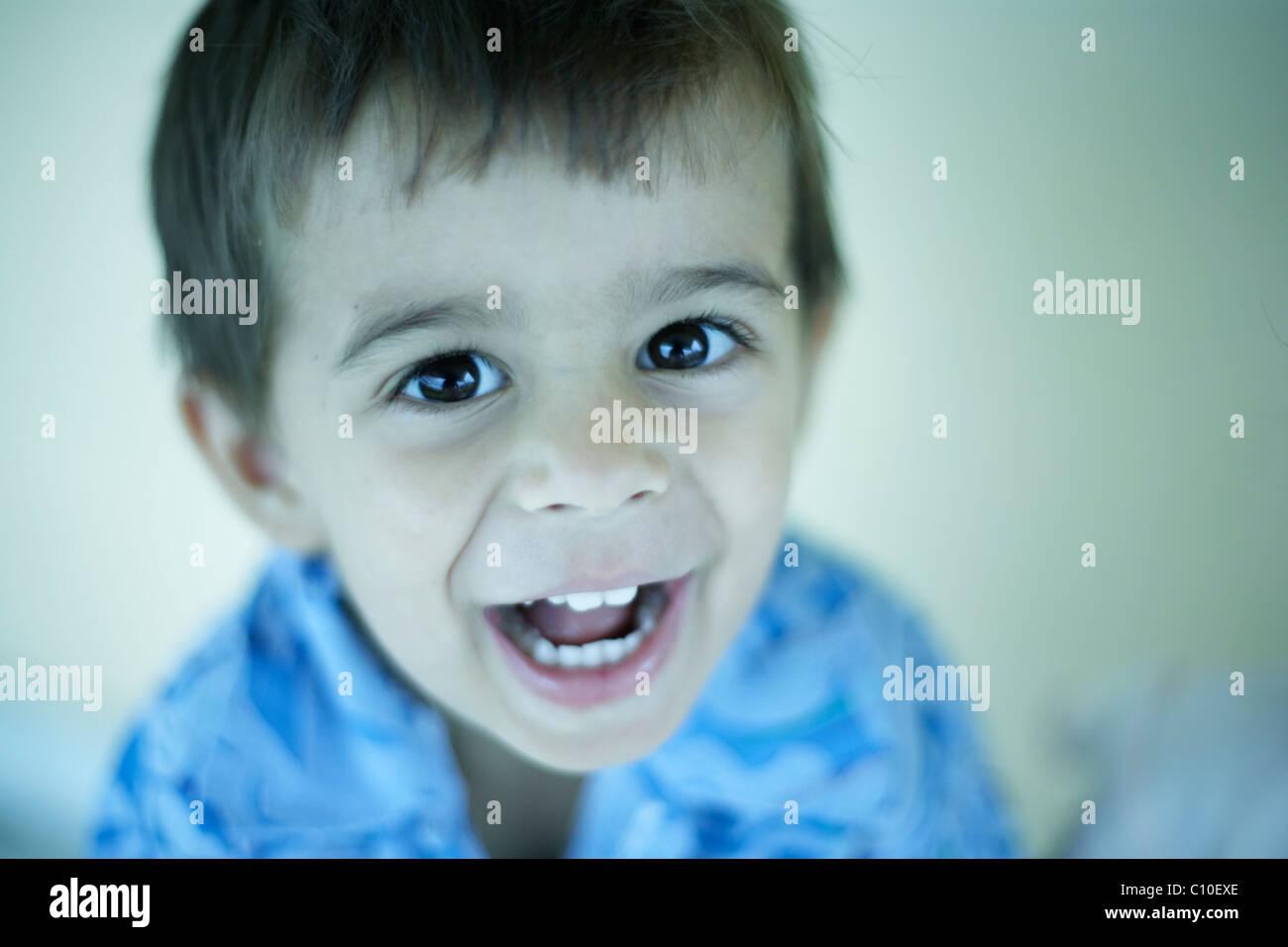 Happy smiling toddler, boy aged 3 - Stock Image