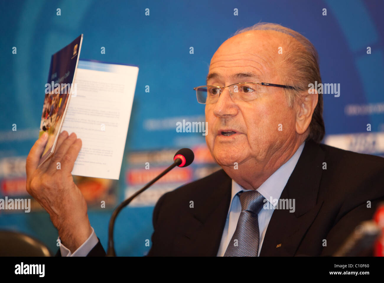 FIFA President Sepp Blatter holds a copy of the FIFA Disciplinary Code while addressing a question at a U20 press - Stock Image