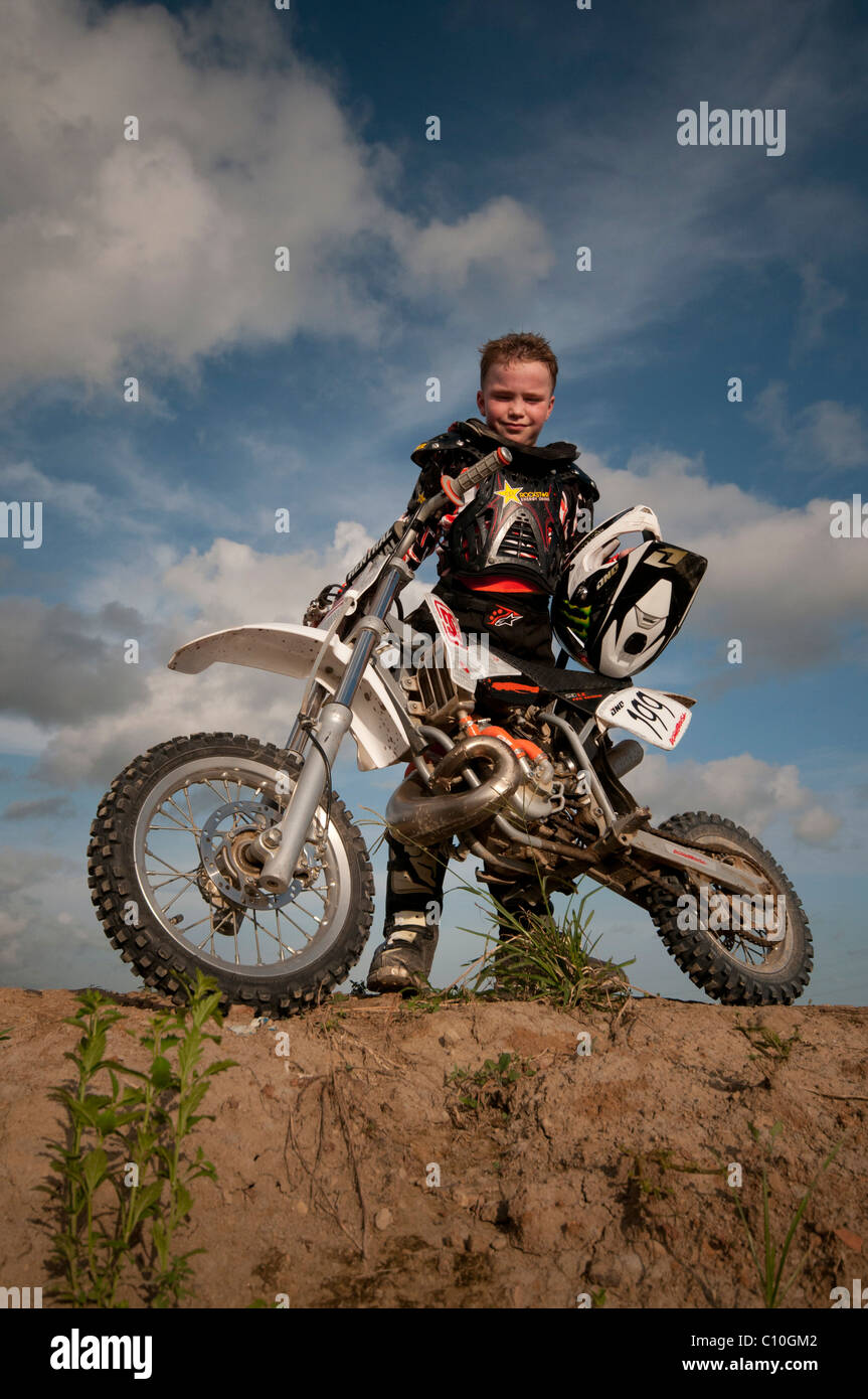 A six year old boy with his motocross bike - Stock Image