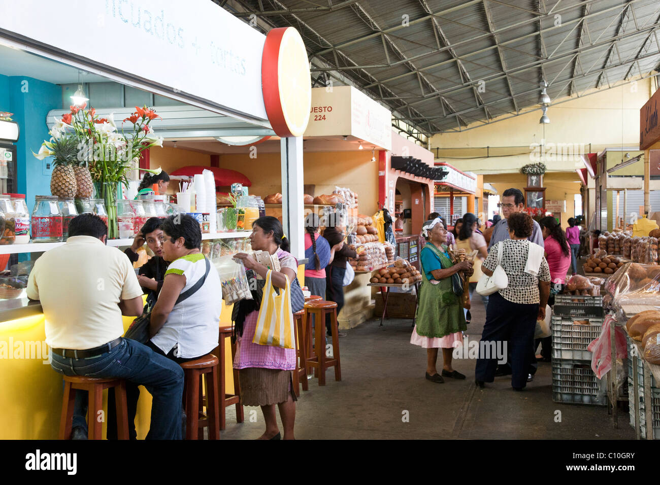 general view 20th November market with indigenous women vendors plying trade among customers shopping or eating - Stock Image