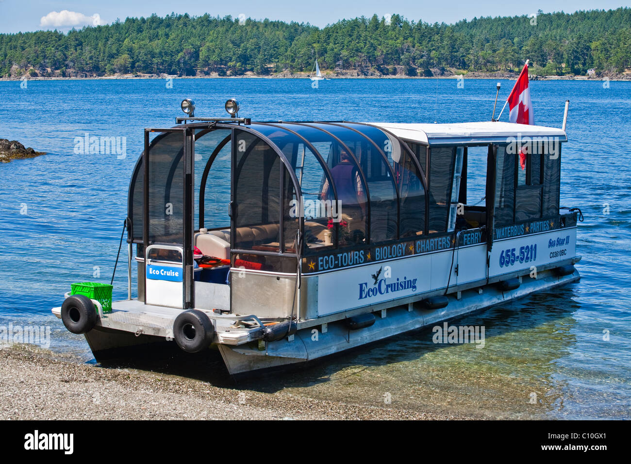 An observation vessel specifically designed for eco-cruising, beached on an island - Stock Image