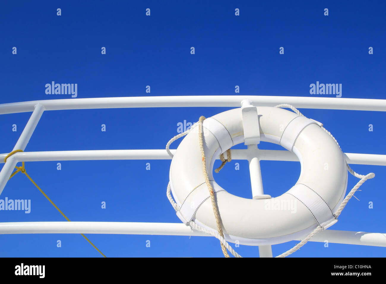 boat buoy white hanged in railing summer vacation blue sky - Stock Image