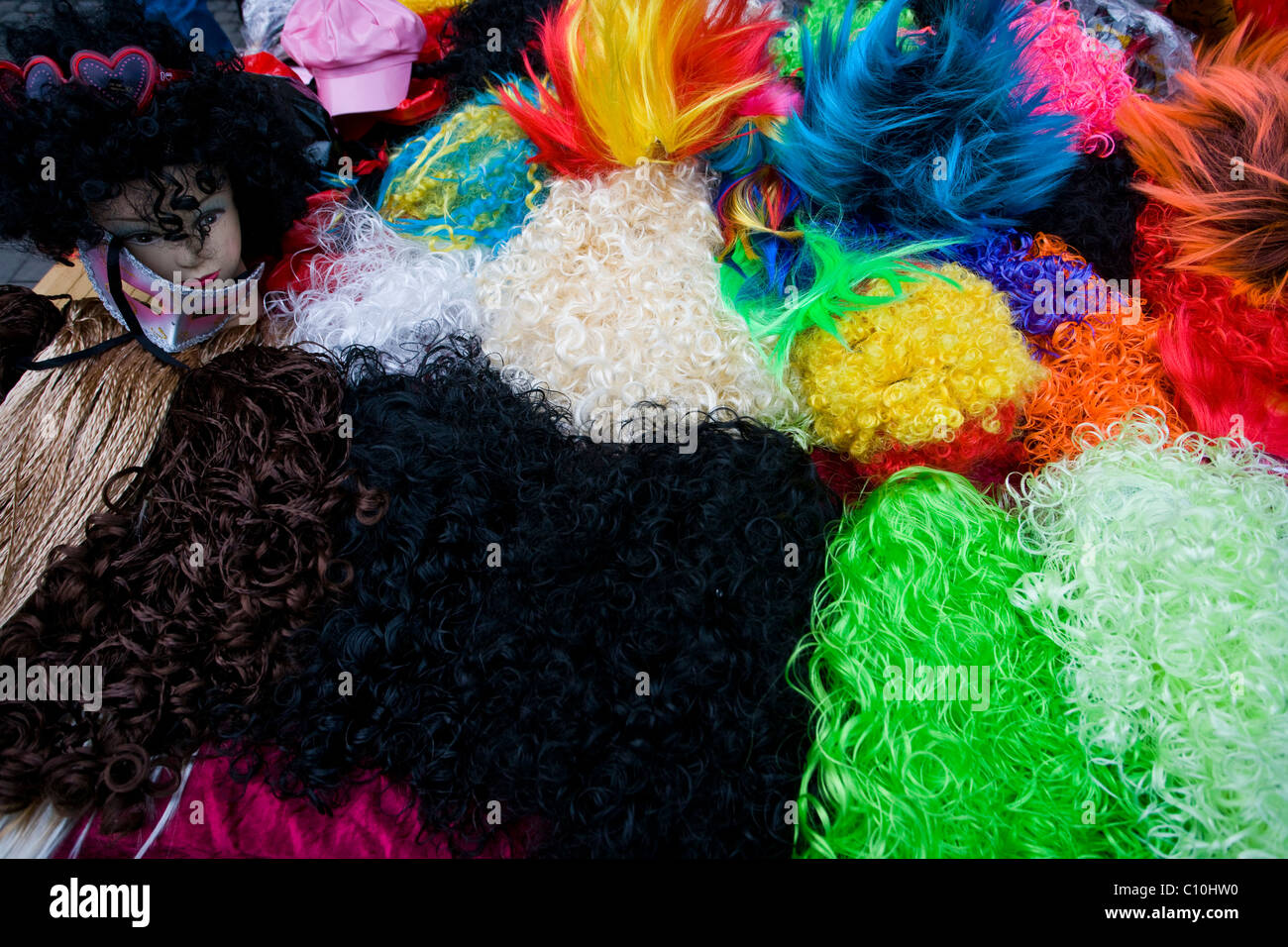 Colourful wigs for costume parties. Carnival in Cologne, Germany. - Stock Image
