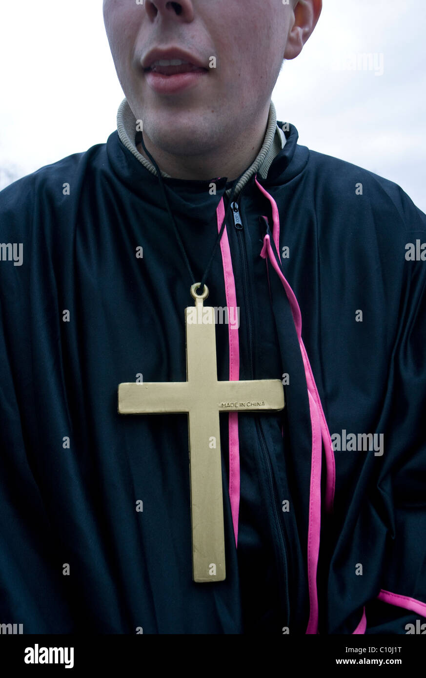 A young man dressed up as a priest during the Carnival Crazy Days in Cologne (Germany) - Stock Image