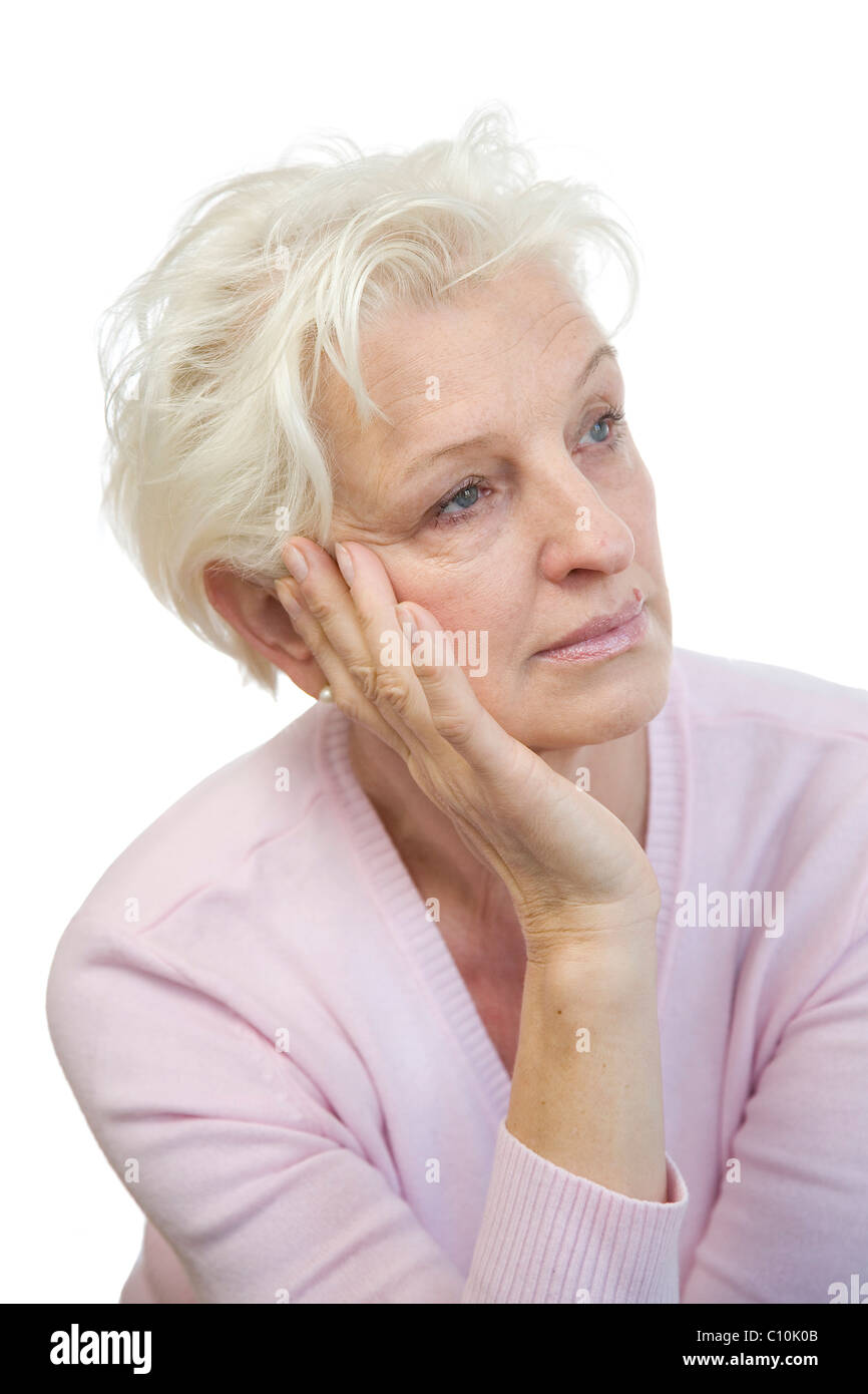 A mature woman looking bored and to the side - Stock Image
