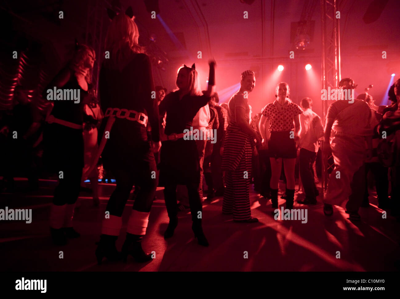 People dancing enjoying nightlife during the Crazy Days of the Carnival in Cologne (Germany) Stock Photo