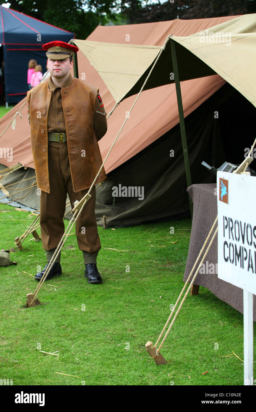 Reconstruction WW2 British Army MP outside field Provost Marshall tent - Stock Image