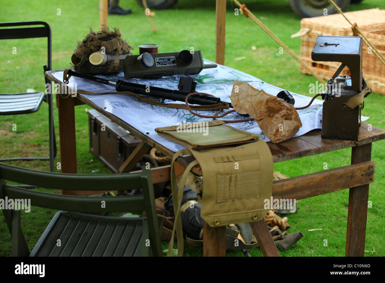 Reconstruction WW2 British Army Field HQ with field radio, Sten gun and map - Stock Image