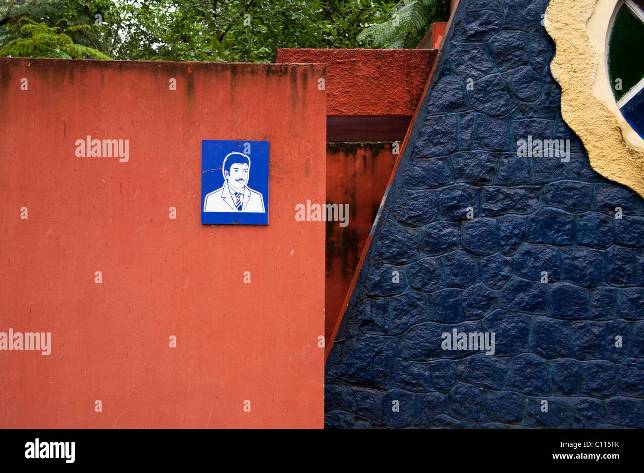Blue men toilette sign on a red wall - Stock Image