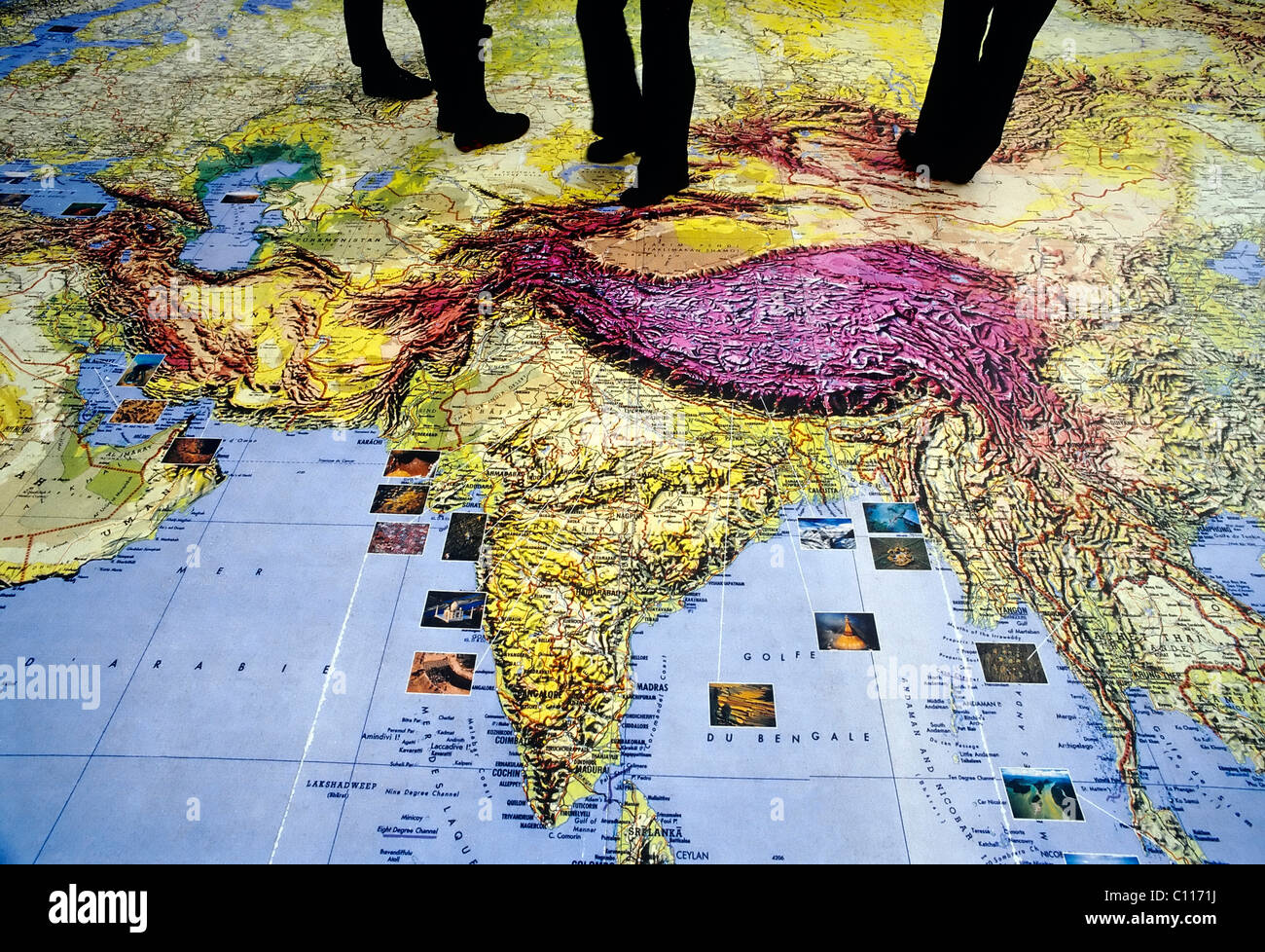 Passers by walking on a world map on the floor detail of asia stock passers by walking on a world map on the floor detail of asia india amsterdam the netherlands europe gumiabroncs Image collections