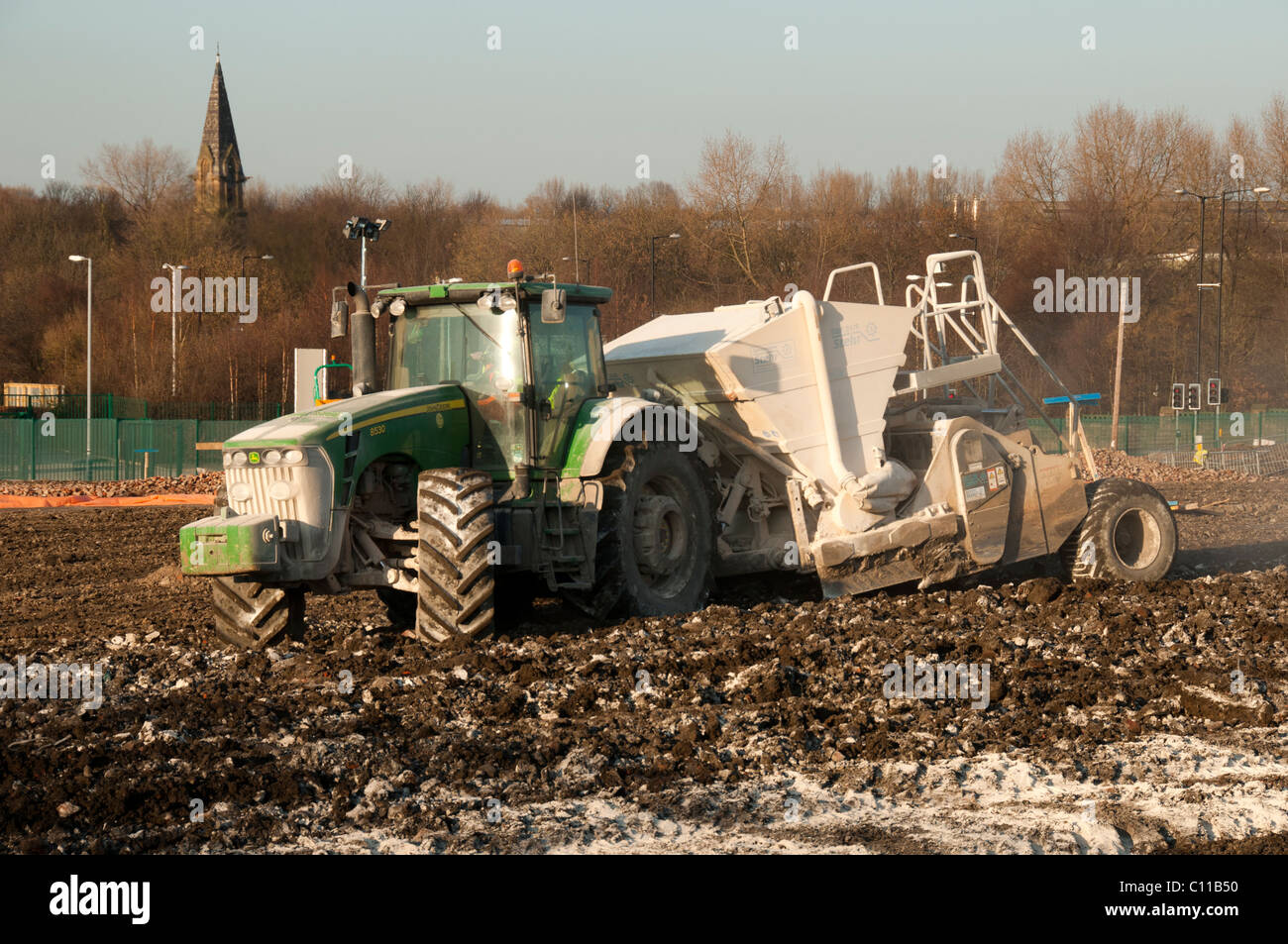 Soil stabilisation. Stehr SBF24/6 dust free lime spreader working on a landscaping project at Eastlands, Manchester, - Stock Image