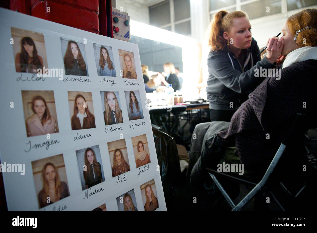 A model posterboard identifies models backstage at the Charles Anastase autumn 2011 collection at the Old Sorting - Stock Image