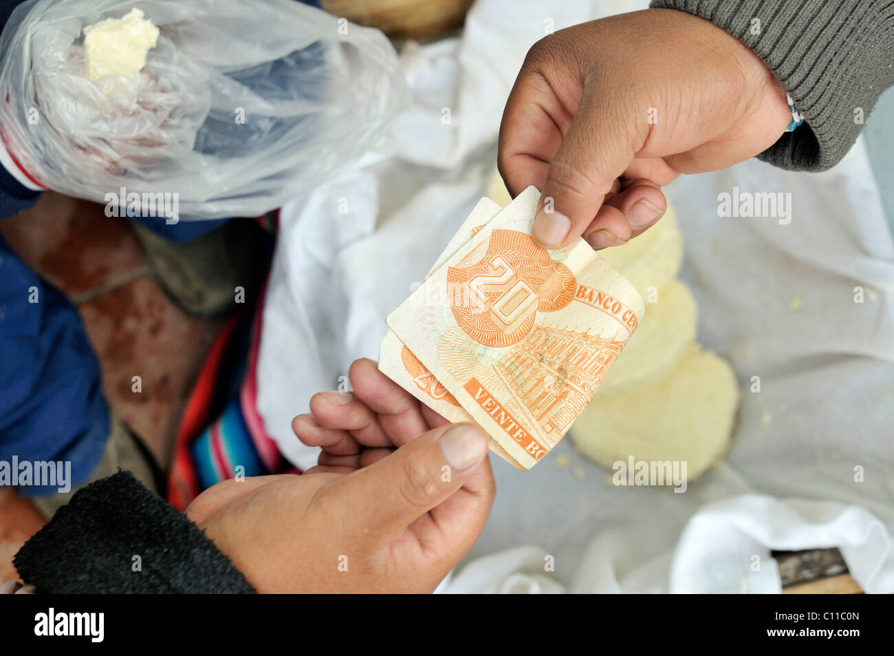 Payment process with a bill, 20 bolivianos, sale of fresh cheese, Bolivia, South America - Stock Image