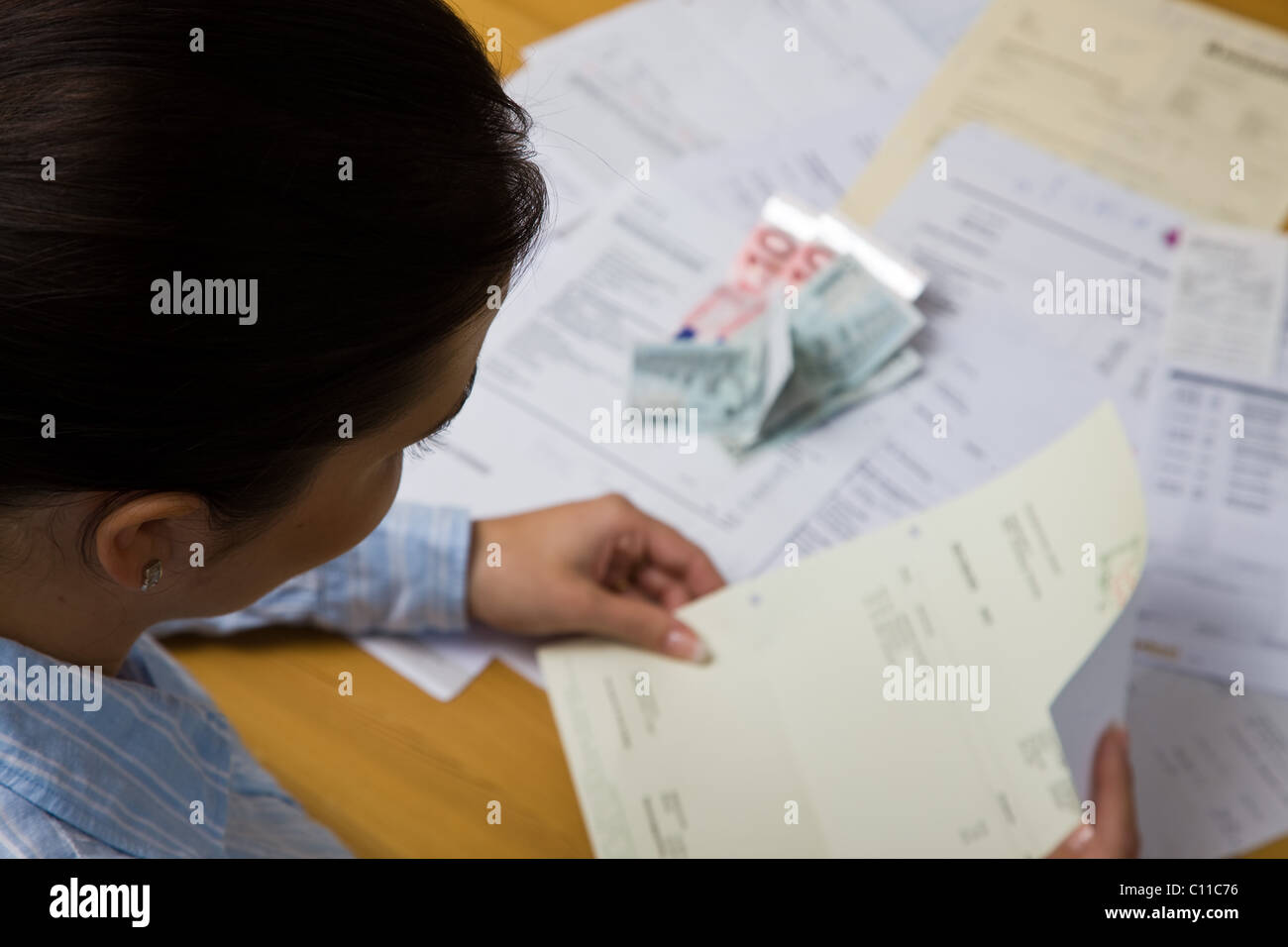 Wife with unpaid bills Stock Photo