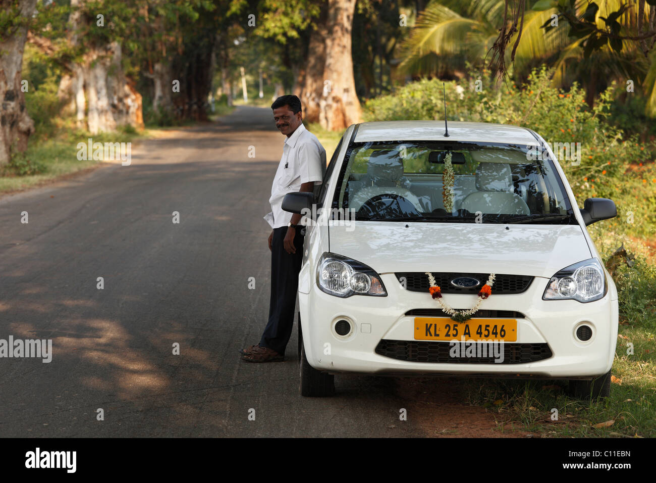 The driver Mr. Manikandan with Ford Escort, Courtallam, Western Ghats, Tamil Nadu, Tamilnadu, South India, India, - Stock Image