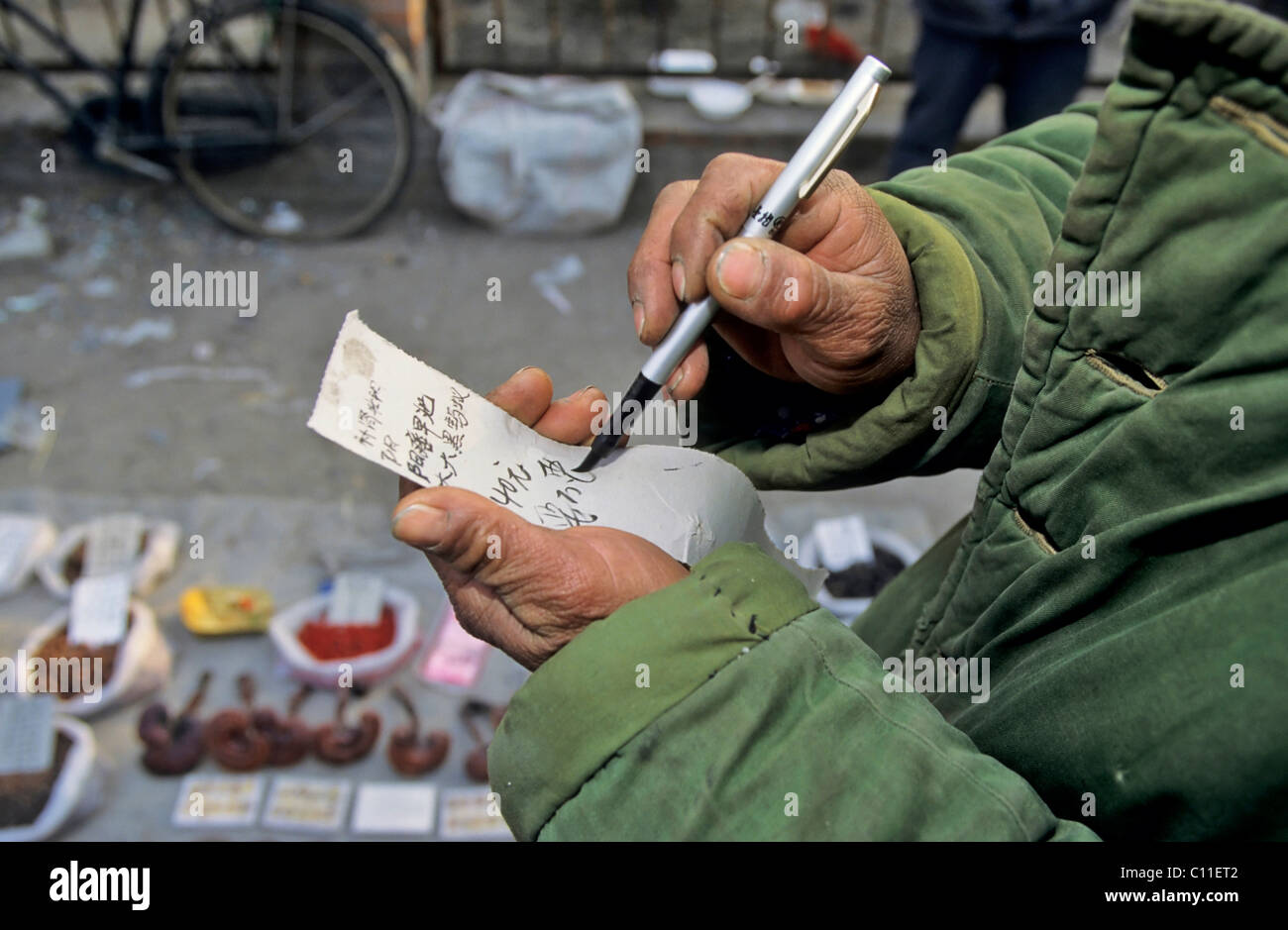 Man with a list, market in Beijing, China, Asia - Stock Image