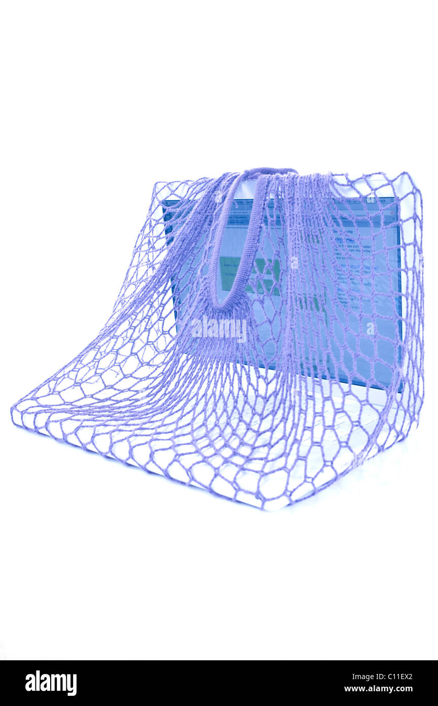 Laptop in a net, symbolic for trapped in a net Stock Photo