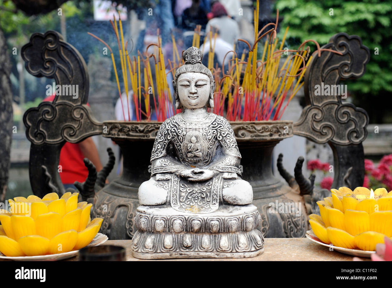 Buddha altar and incense in front of the One Pillar Pagoda, Hanoi, North Vietnam, Vietnam, Southeast Asia, Asia - Stock Image